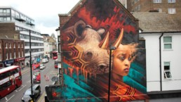 Rhino and girl mural painted by Sonny in Croydon, London as part of his To The Bone street art project
