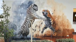 two tigers playing Street art mural painted by Sonny for aWalls Mural Project in Wynwood Miami during Art Basel 2018