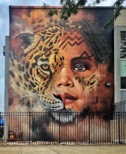Sonny Street Art Mural of Amazonian Girl and Jaguar Face Painted in Williamsburg, Brooklyn New York as part of Climate Week 2018 in partnership with UNICEF and Greenpoint Innovations