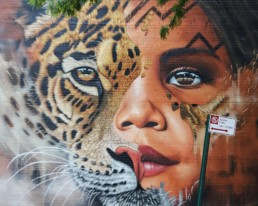 Close up of Sonny Street Art Mural of Amazonian Girl and Jaguar Face Painted in Williamsburg, Brooklyn New York as part of Climate Week 2018 in partnership with UNICEF and Greenpoint Innovations