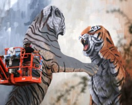 Sonny painting tiger mural painted during Art Basel Miami, for aWalls Mural Project in Wynwood