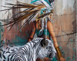 Close up of Sonny Street Art Mural of girl and white tiger painted in the streets of Ireland for Waterford Walls Festival 2018